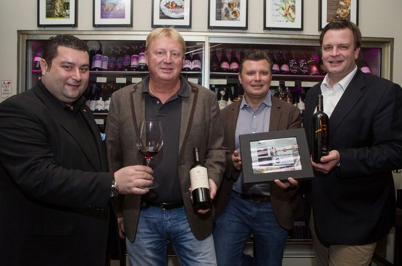 Alexander Andreadis, Franz Grossauer, Christof Widakovich und Robert Grossauer präsentieren das neue Wine iPad (Foto Volker Wohlgemuth)