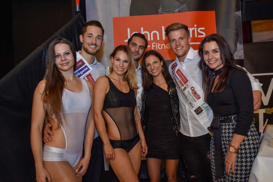 """Die Gewinner der Mister Austria Wahl 2016 mit """"Dance Arts Austria""""-Geschäftsführerinnen Isabella Schmon-Ruhri und Barbara Hammer-Agkün sowie zwei 'Pole-Dancer' (Foto Mister Company/Pail)"""